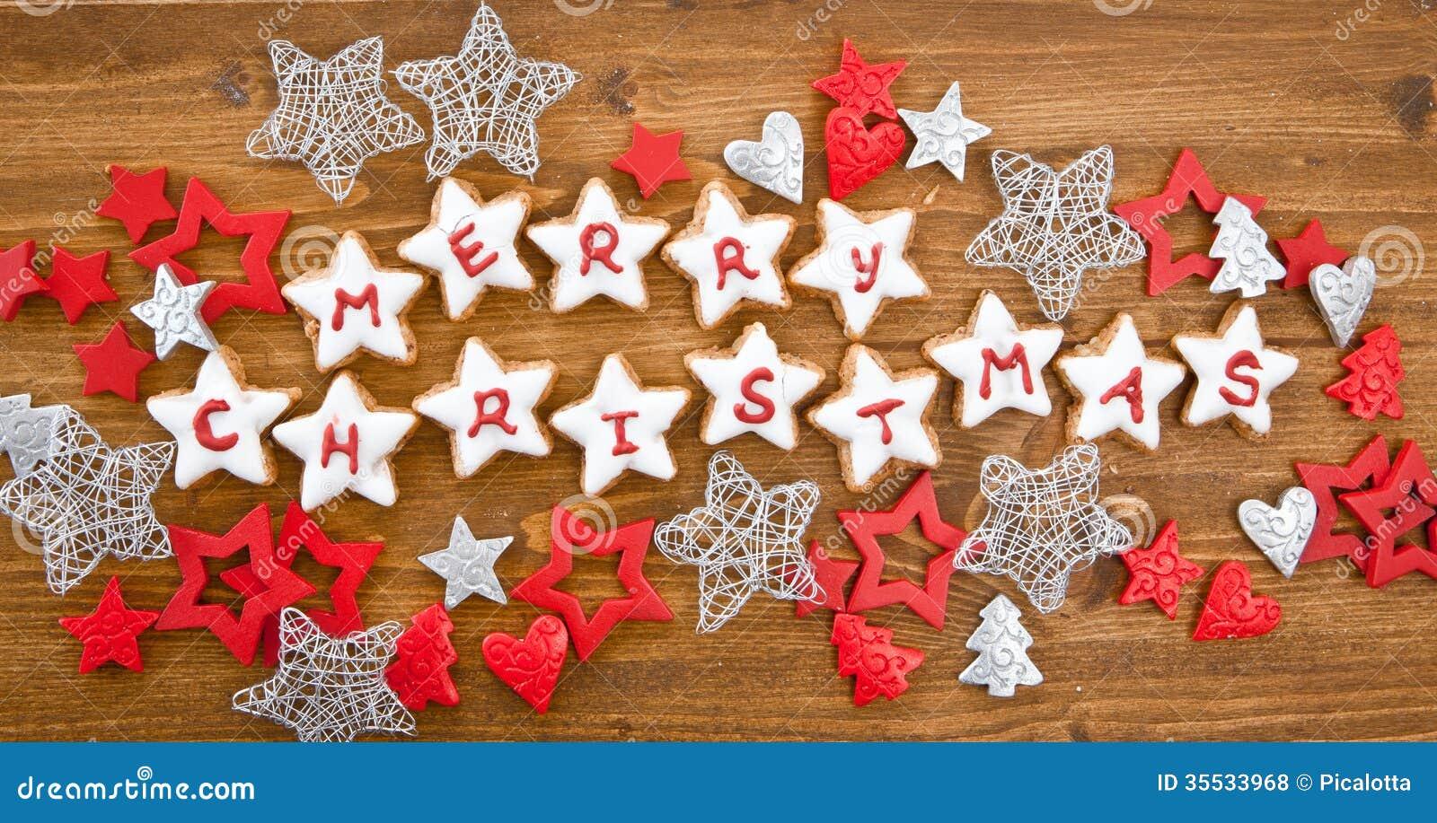 Frohe weihnachten geschrieben auf pl tzchen lizenzfreie for Xmas bilder kostenlos