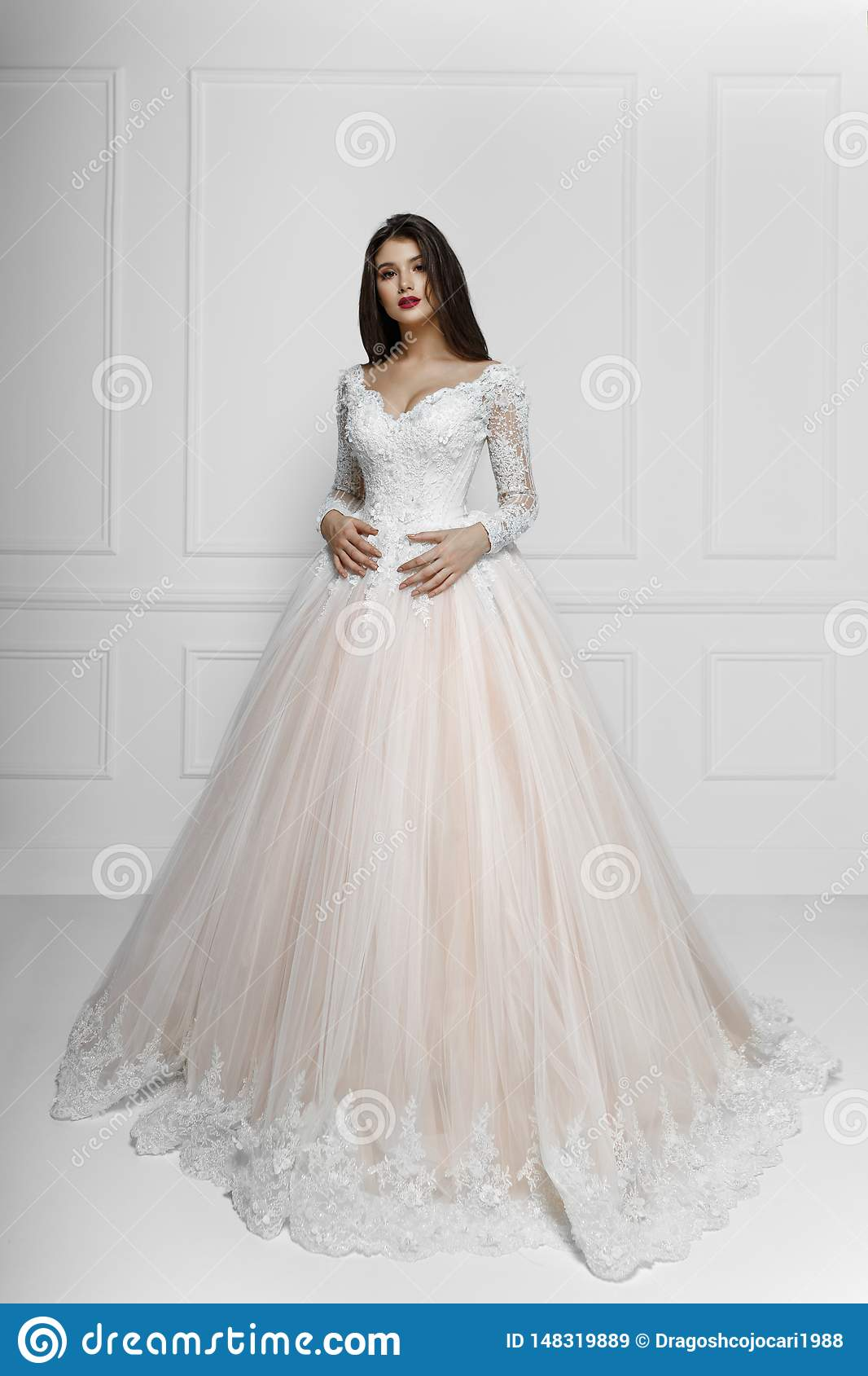 Frontal View Of A Fashion Model In Long Elegant Wedding Dress
