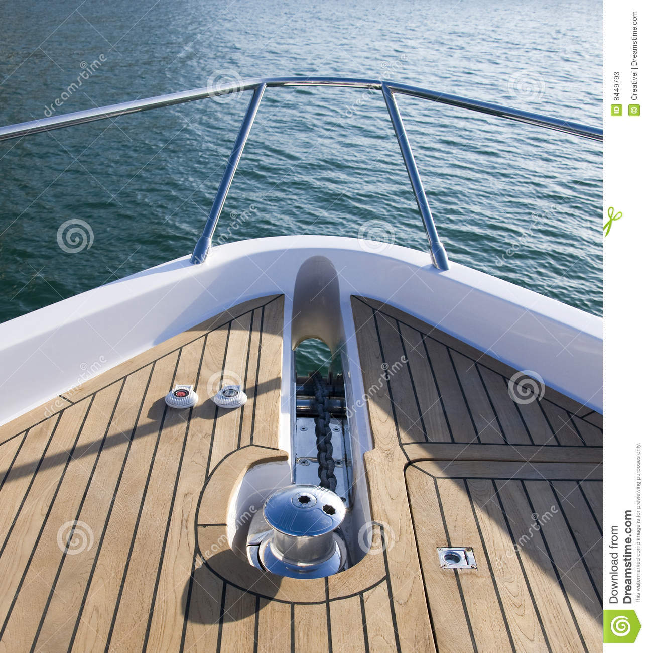 The front deck of a boat with the anchor out. .