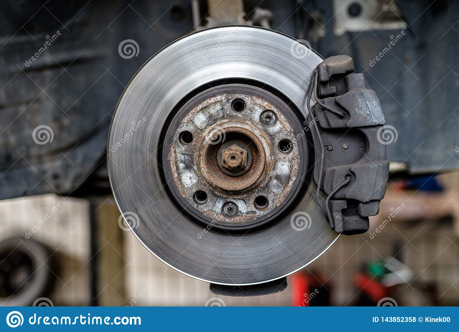 Car Brake Pads >> Front Brake Discs With Caliper And Brake Pads In The Car On
