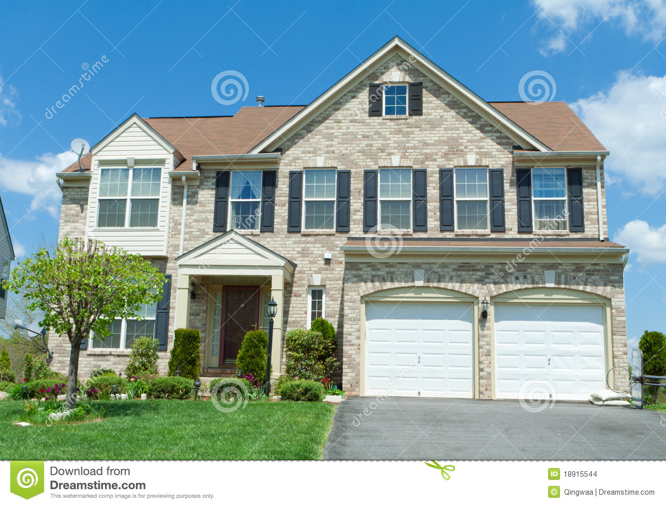 Front brick faced single family house suburban md stock for Garage md auto