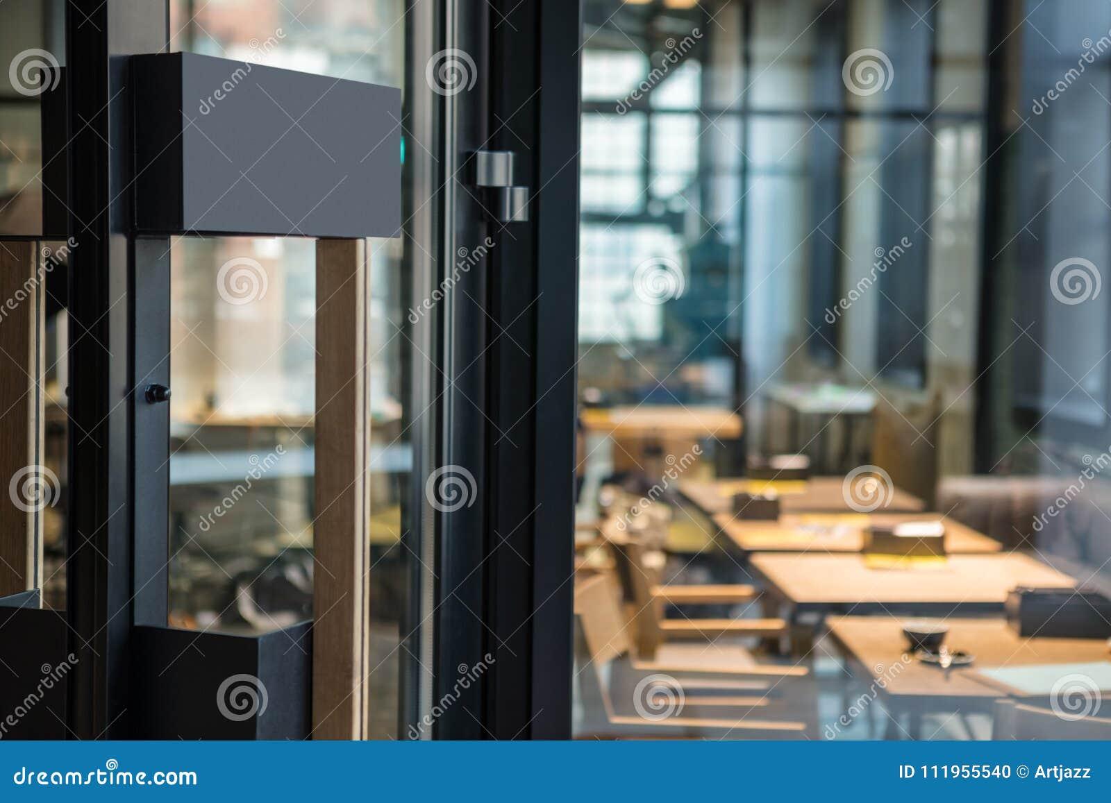 Restaurant Door Handle With Pull Sign On Glass Doors Stock Photo