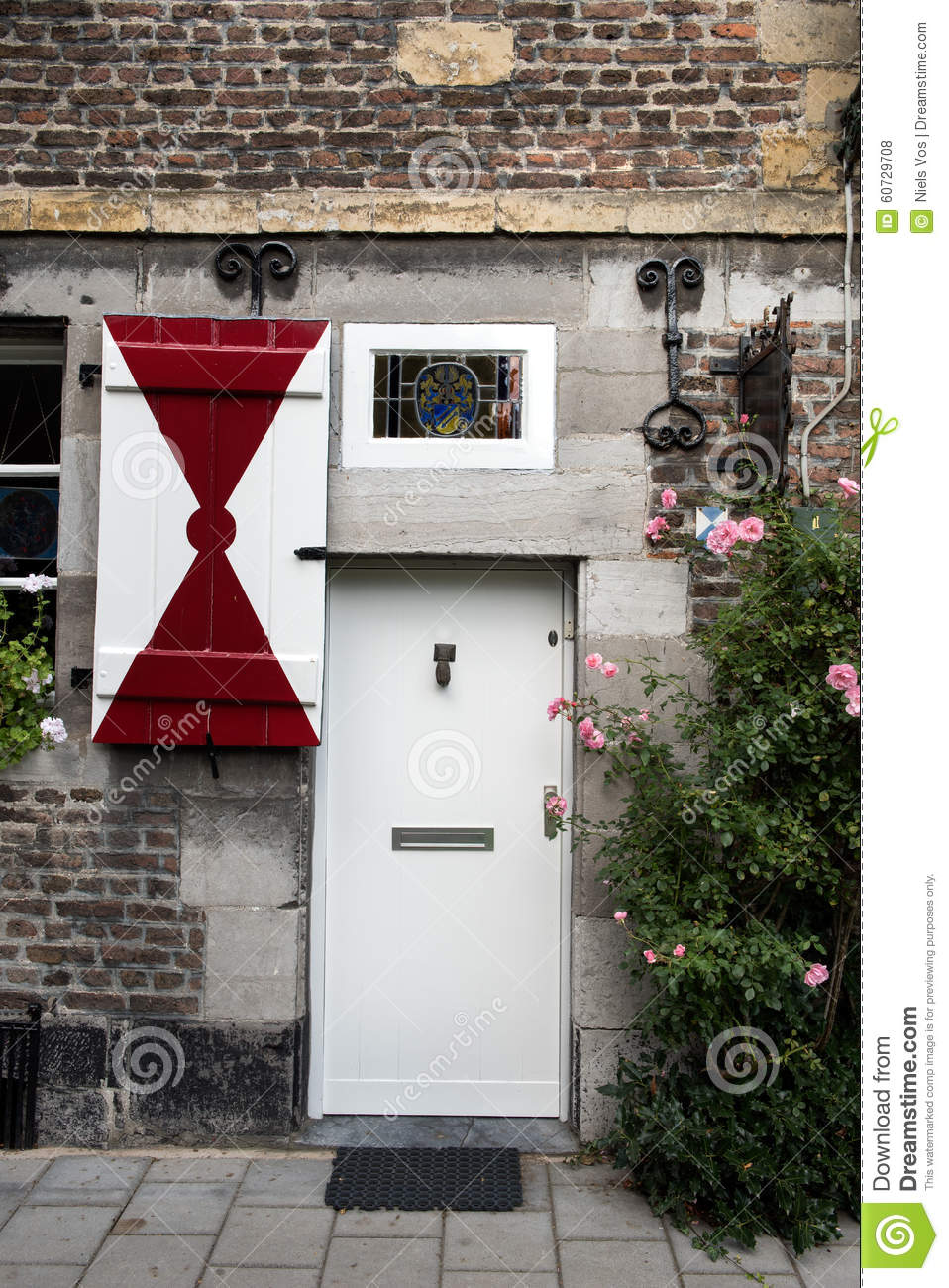 Front Door With Red White Shutters On A Medieval House Stock Photo