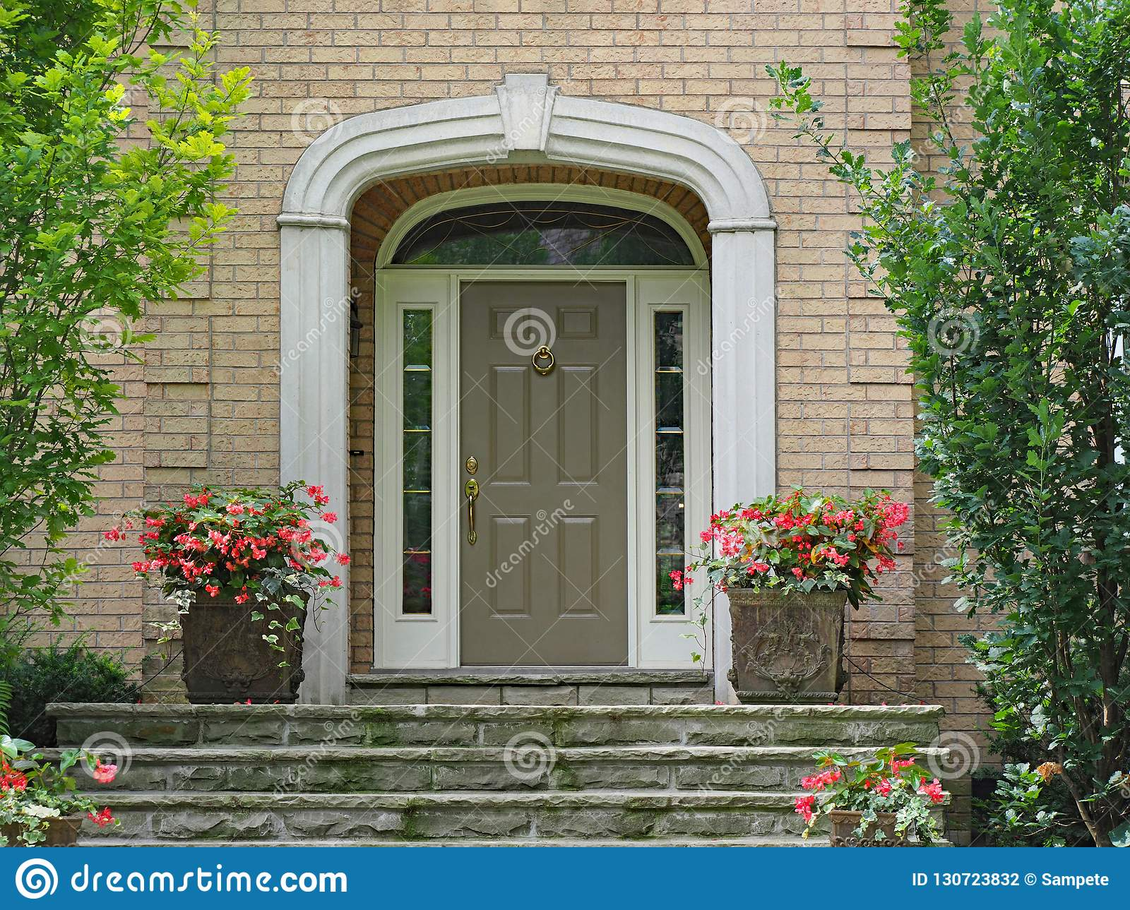 Front Door With Sidelights And Transom Window Stock Photo