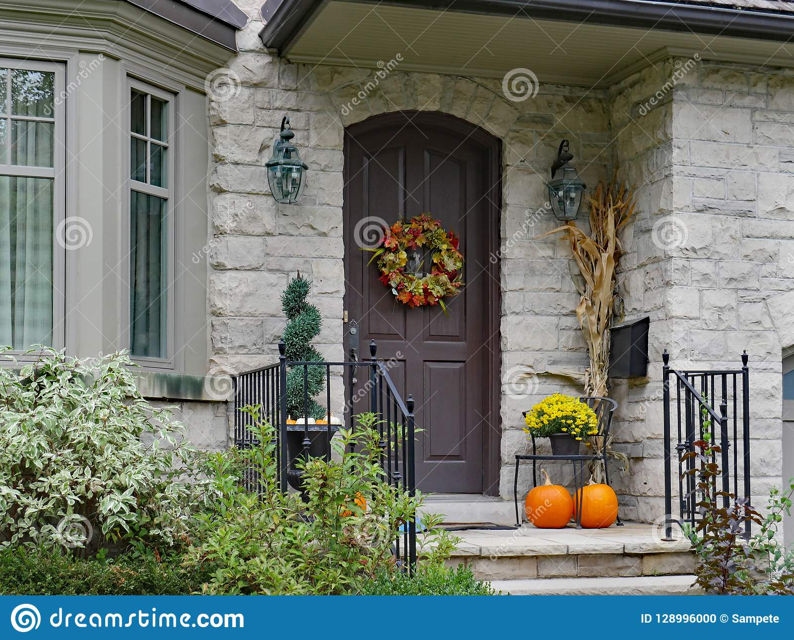 Front porch with pumpkins stock photo image of wreath
