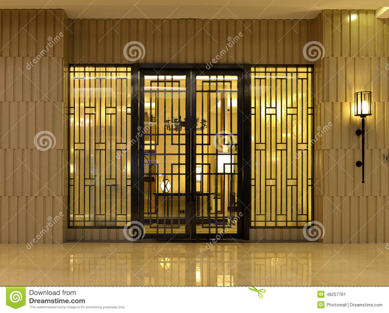 Front Door Of An Upscale House With An Illuminated Wall Light Stock ...