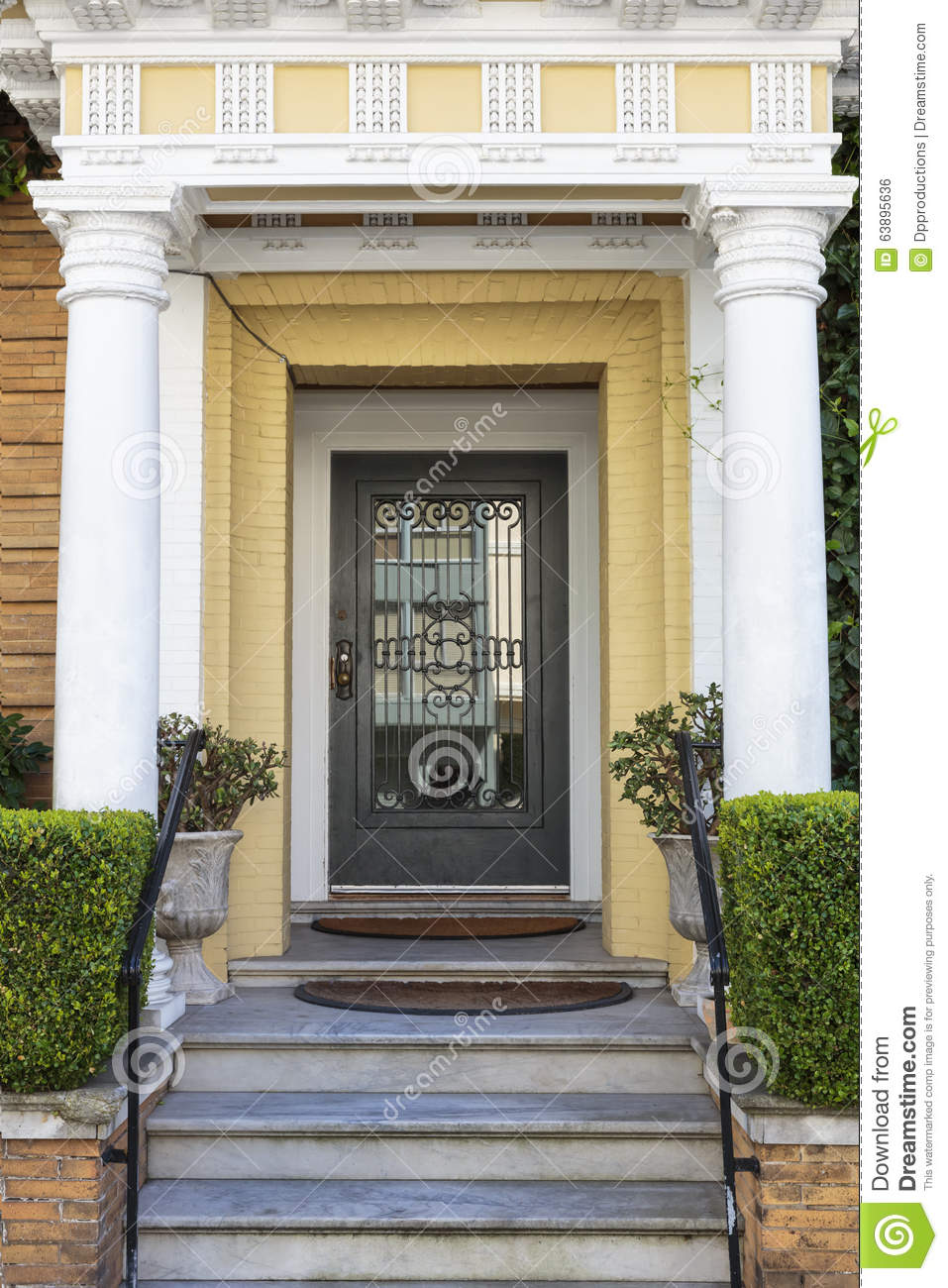 Paint For Concrete Pillars : Front door vertical with yellow paint stock photo image