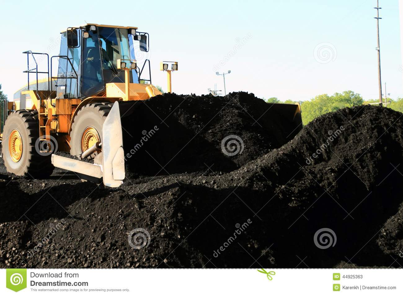 Front End Loader Moving Piles Of Coal