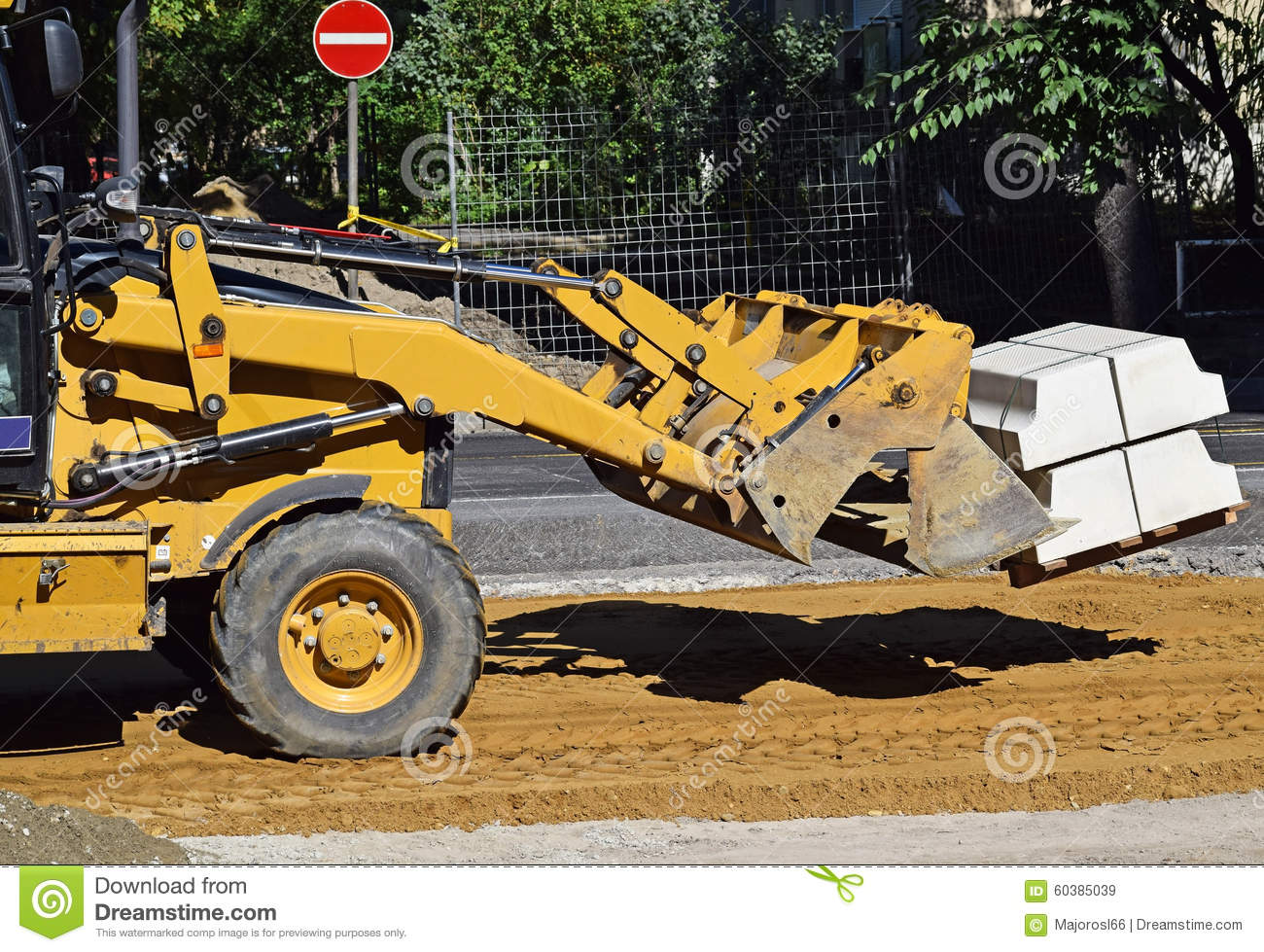 Front end loader at the road construction