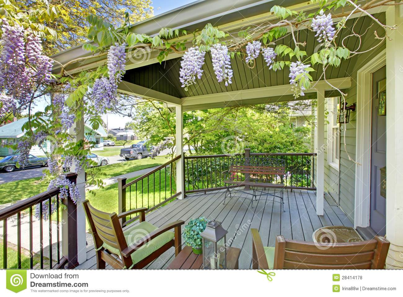 Front House Porch With Chairs And Flowers Stock Photo