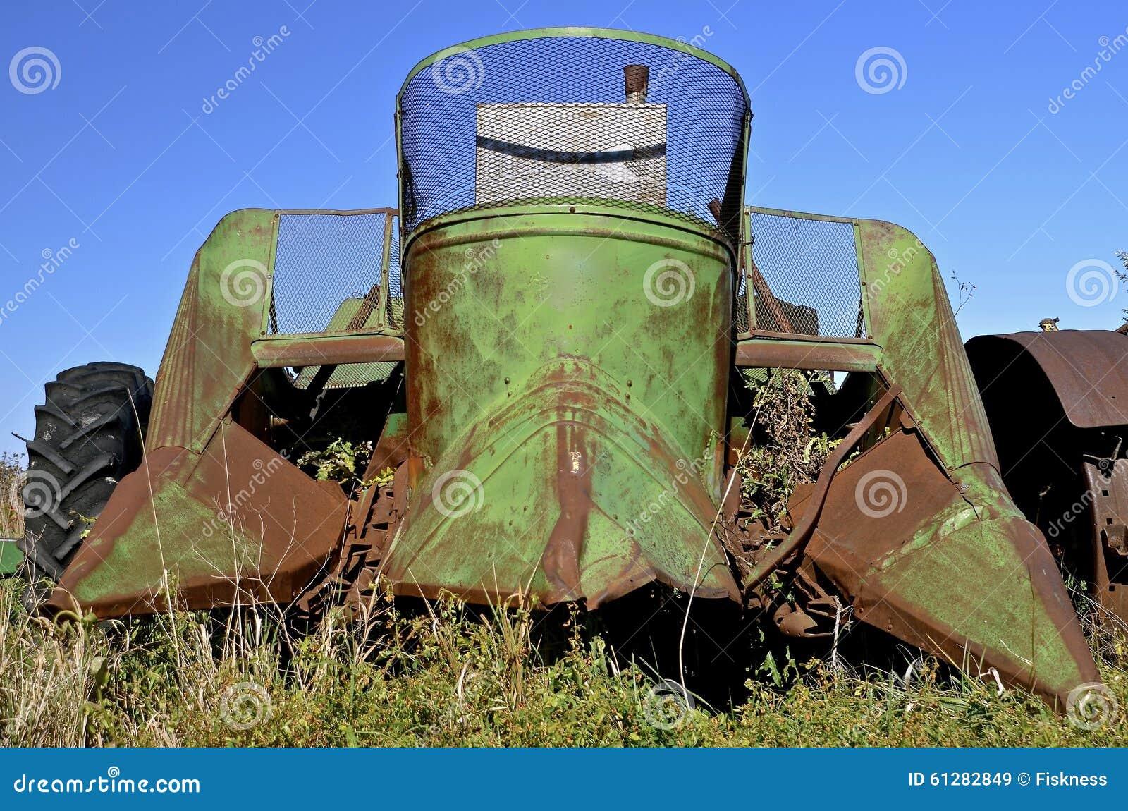 Cartoon Tractor Corn Picker : Farm equipment graveyard royalty free stock image