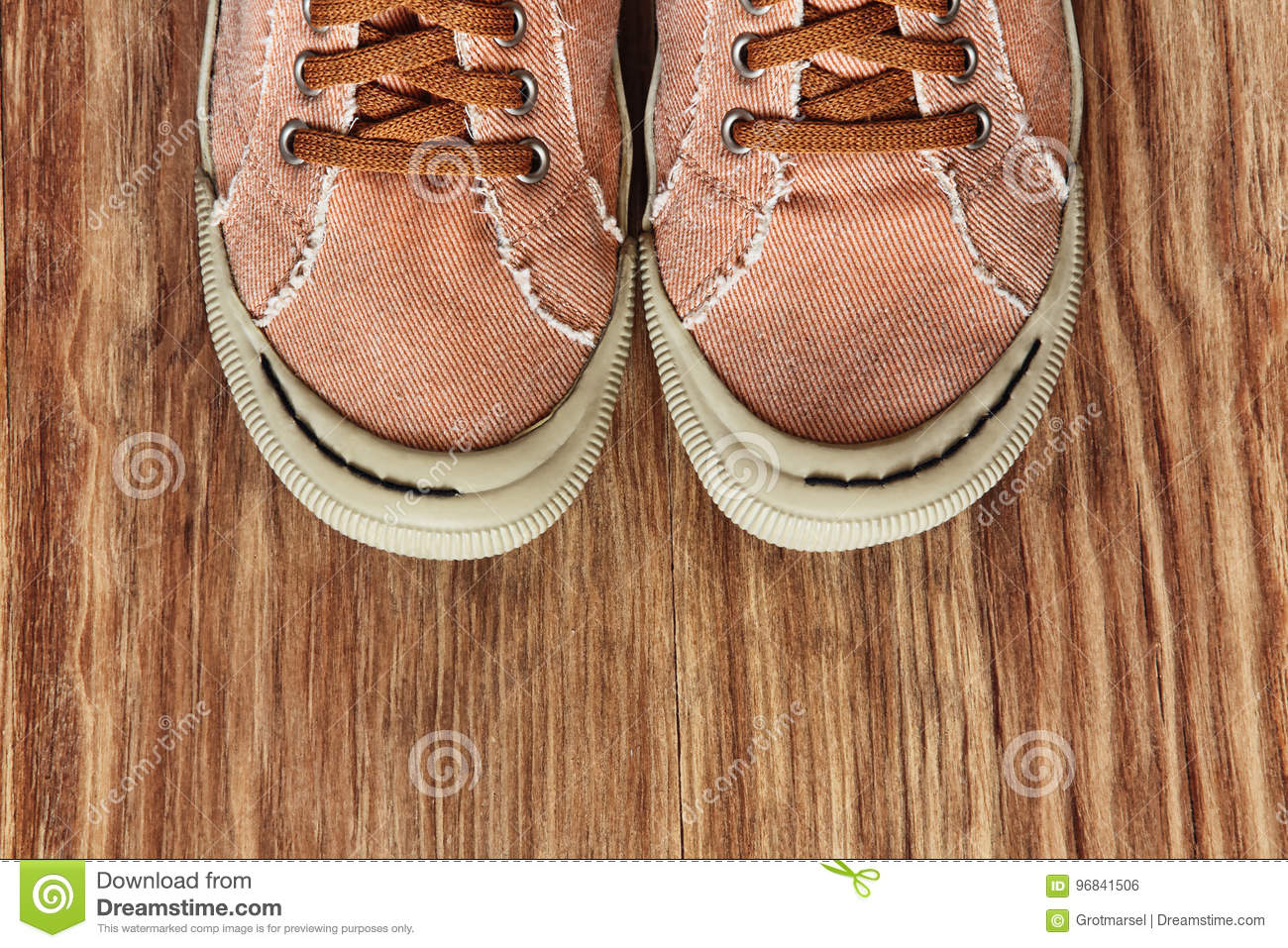 Front part of Gym shoes on grunge wooden background.Top view.