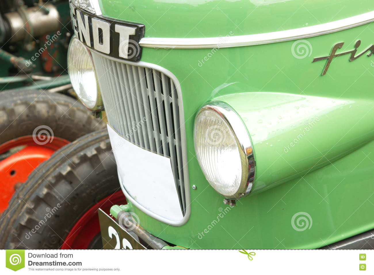 Tractor With Headlights : Front part with headlights of fendt green tractor