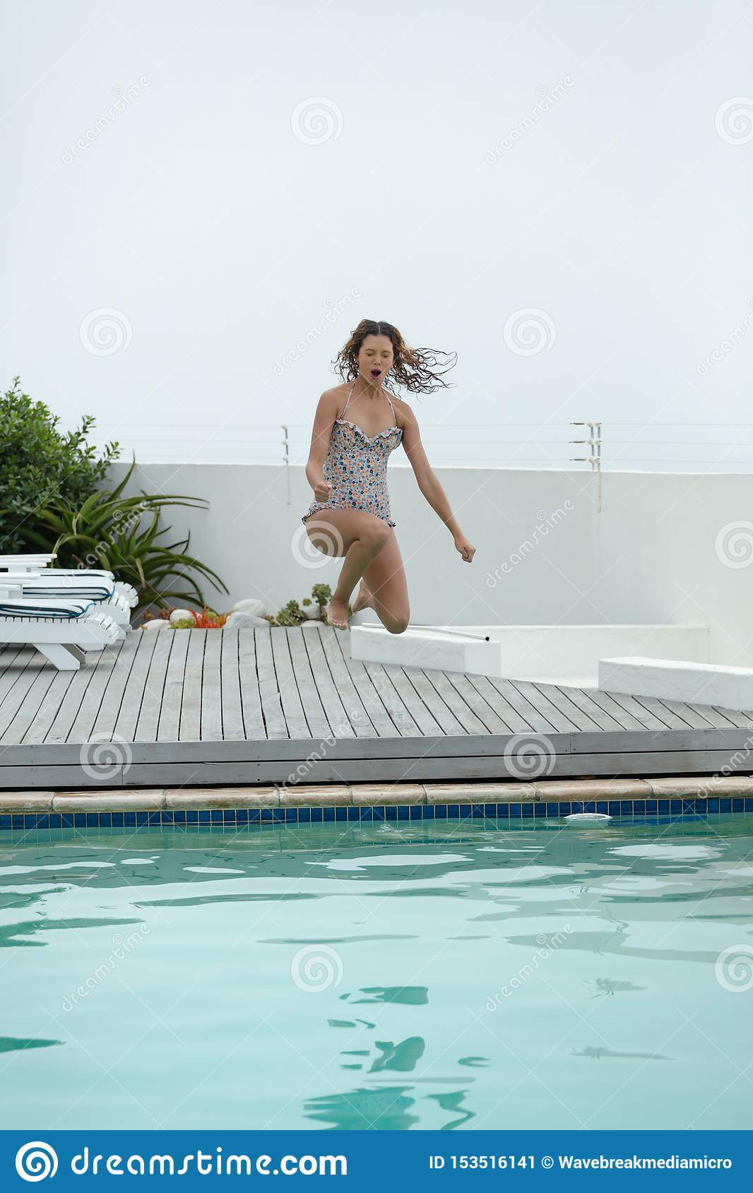 Woman Jumping In Swimming Pool At The Backyard Of Home Stock Image Image Of Person Mixedrace 153516141