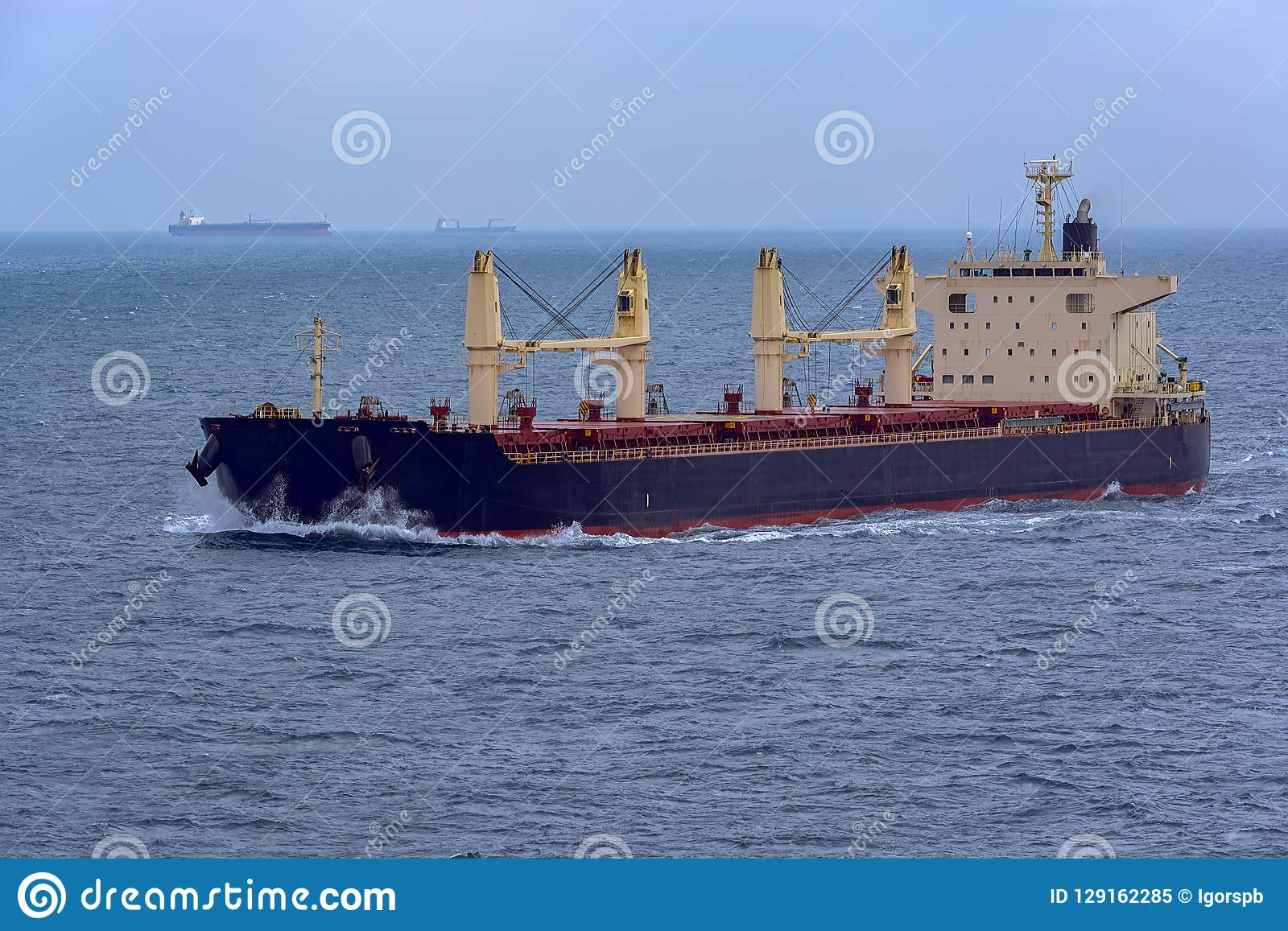 Front view of bulk carrier vessel.