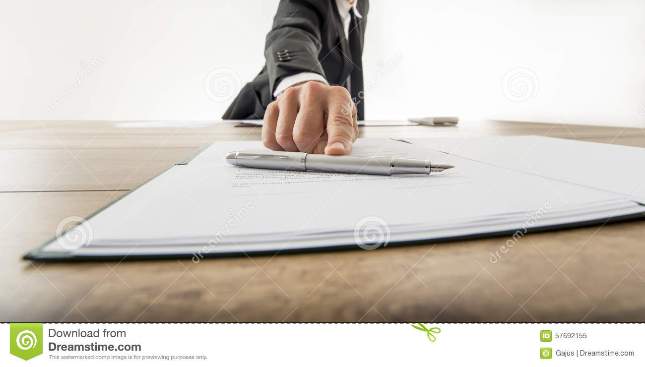 Front view of a businessman offering you to sign a document or c