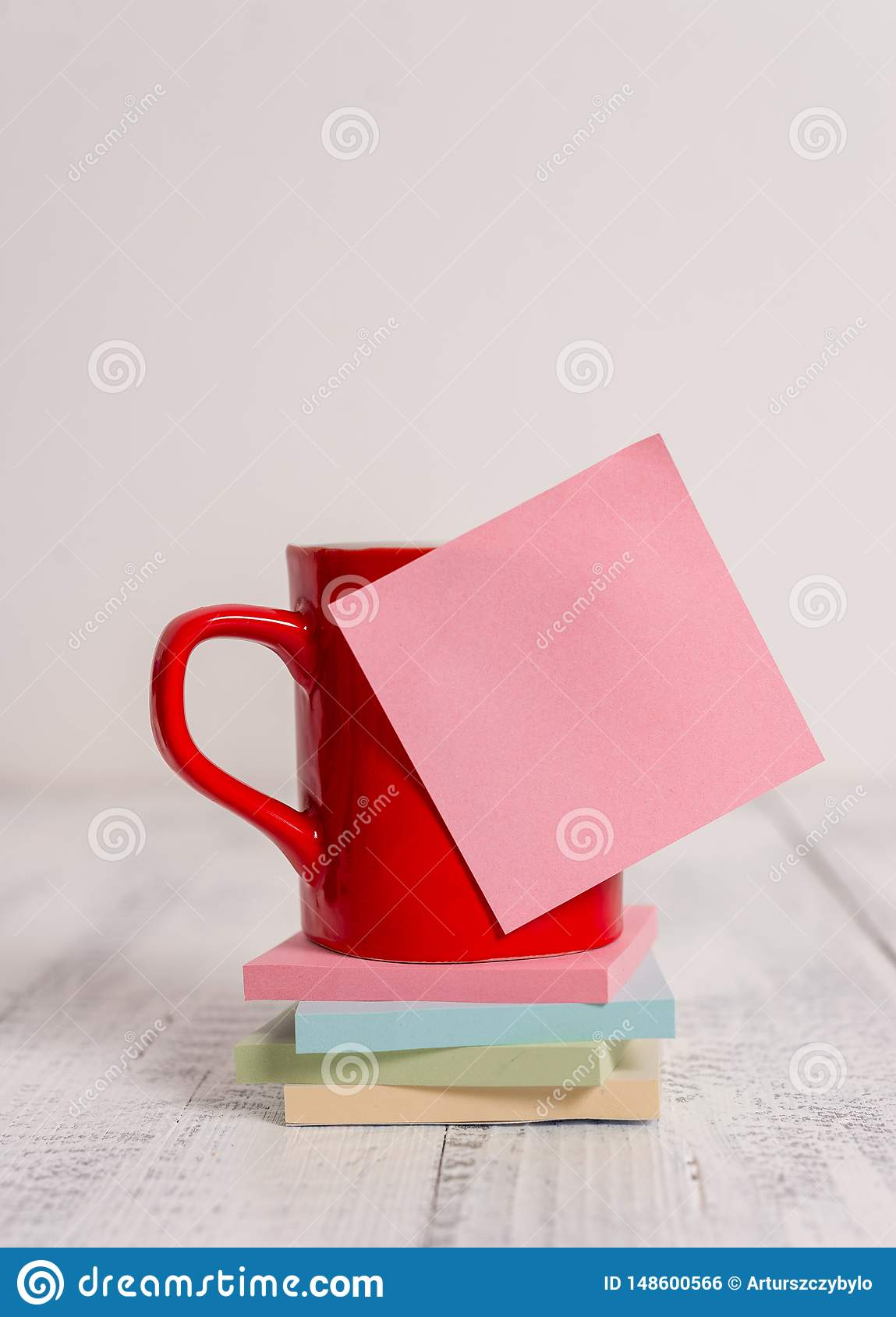 Front view coffee cup mug hot drinks blank colored sticky note stacked note pads lying retro vintage rustic old table