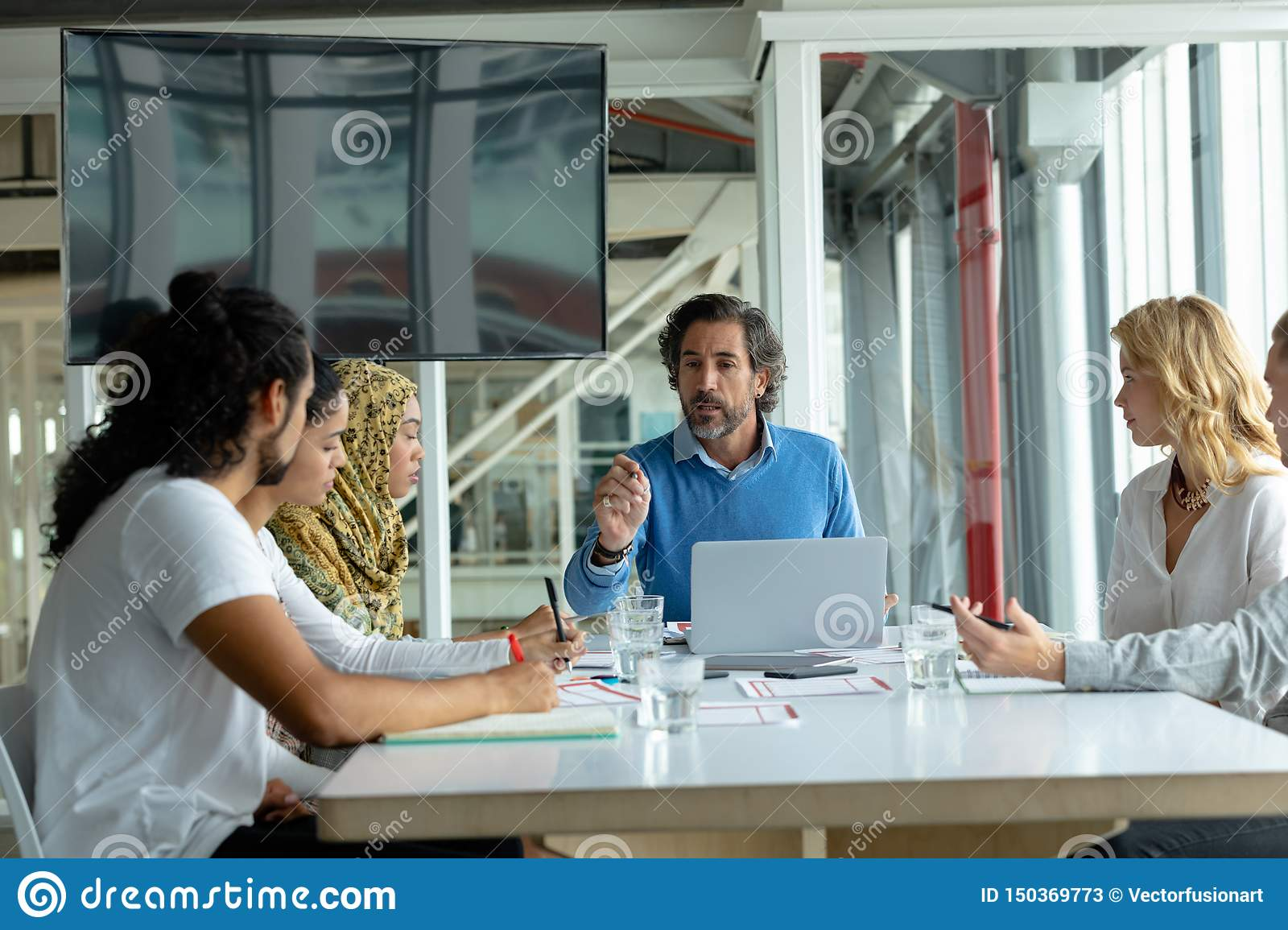 Business people discussing with each other in meeting at conference room in a modern office