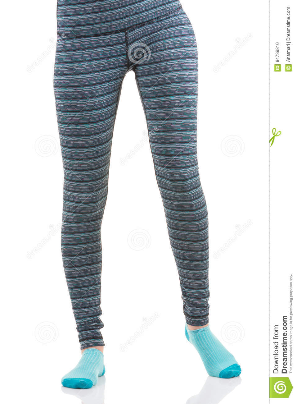 ff56840ccf282 Front view of fit woman legs in colourful striped sports leggings and blue  socks on white isolated background