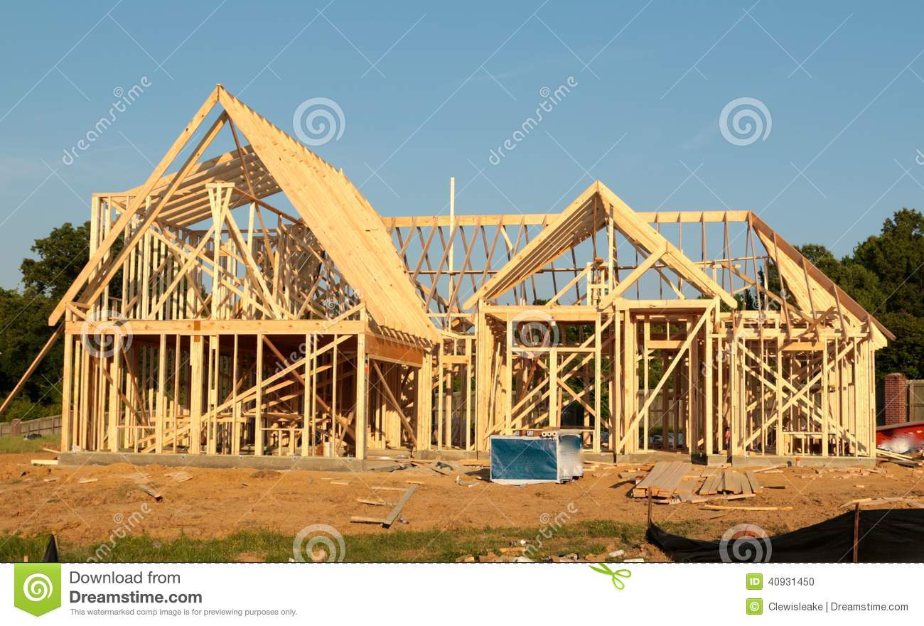 Front view of the frame of a suburban home under for What is a frame home