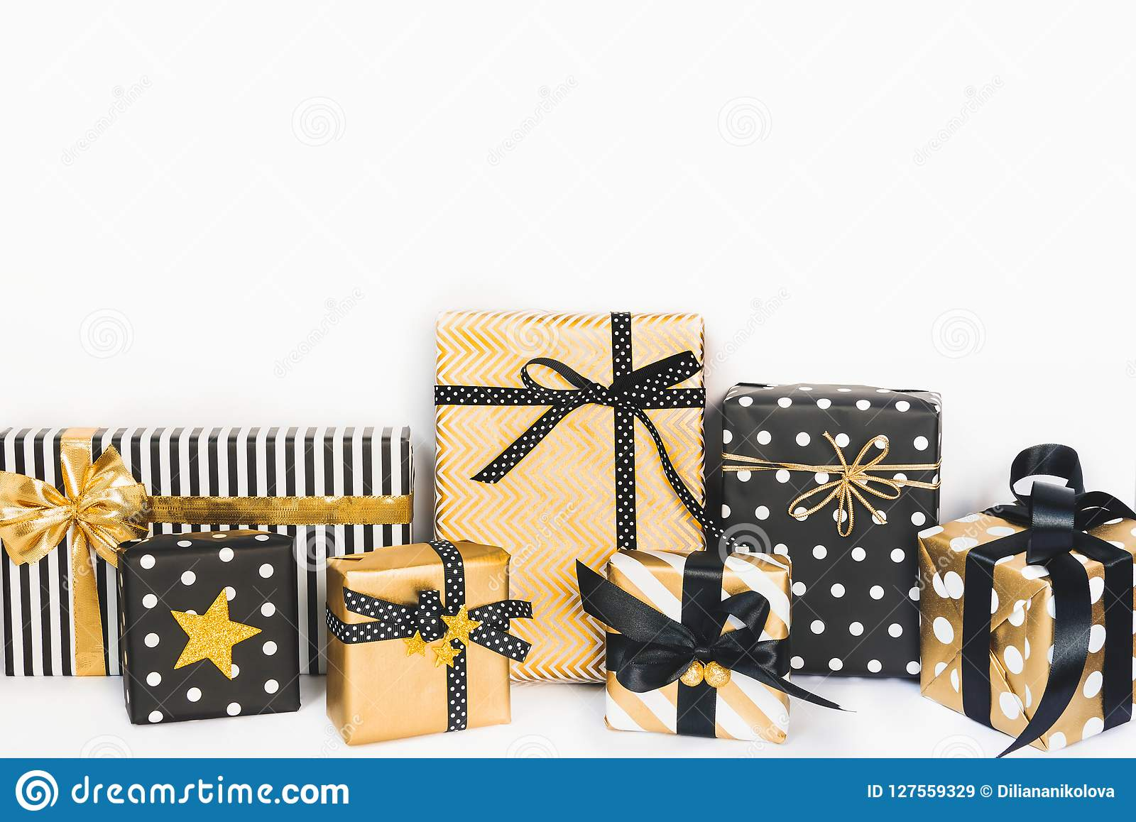 Front view of gift boxes in various black, white and golden designs. Copy space. A concept of Christmas, New Year, birthday celebr