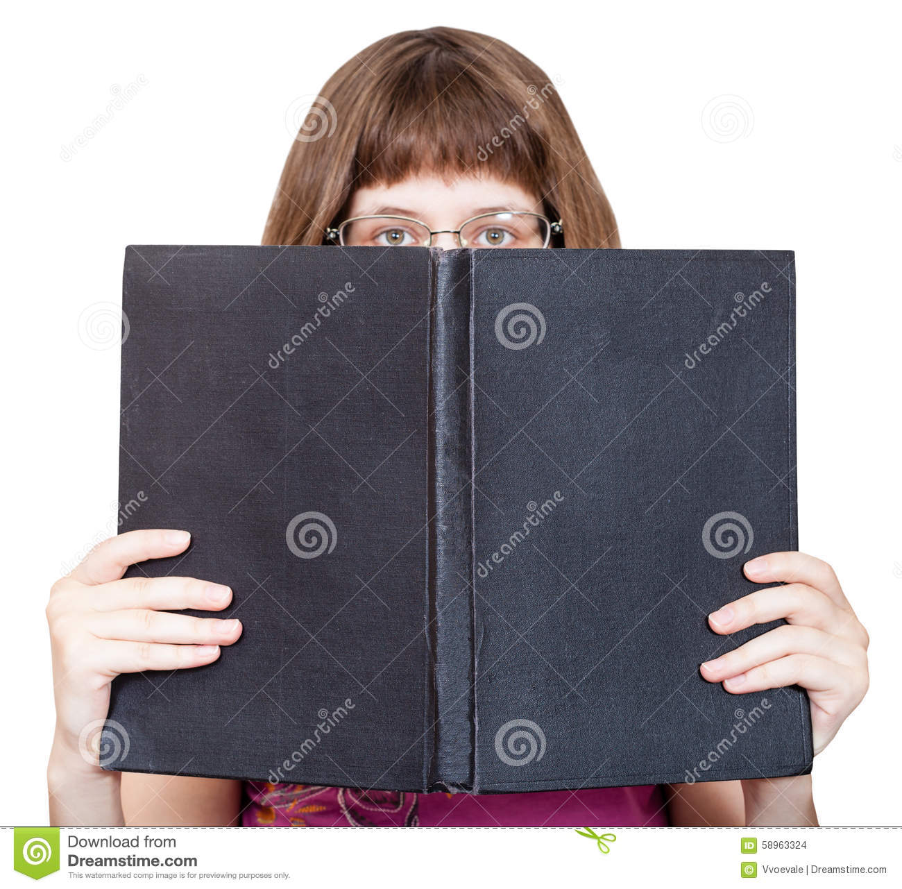 Book Cover White Girl : Front view of girl with spectacles looks over book stock