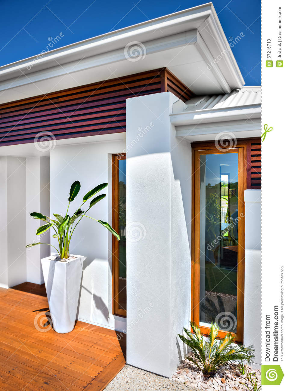 Front view of a modern house and blue sky stock image for Modern house front view