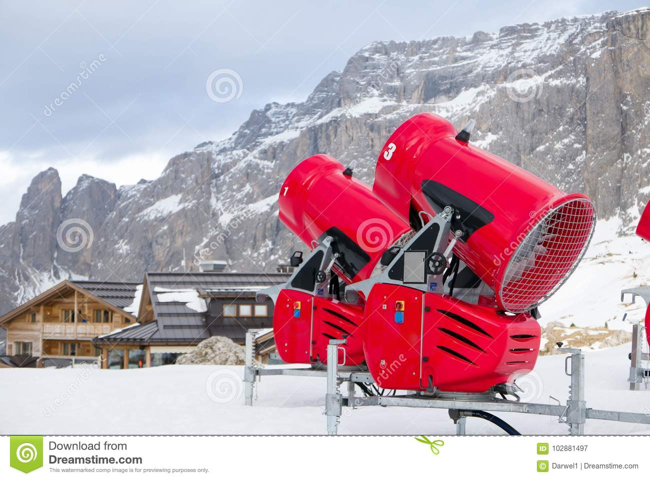 front view of two snow cannons in alpine ski resort stock image