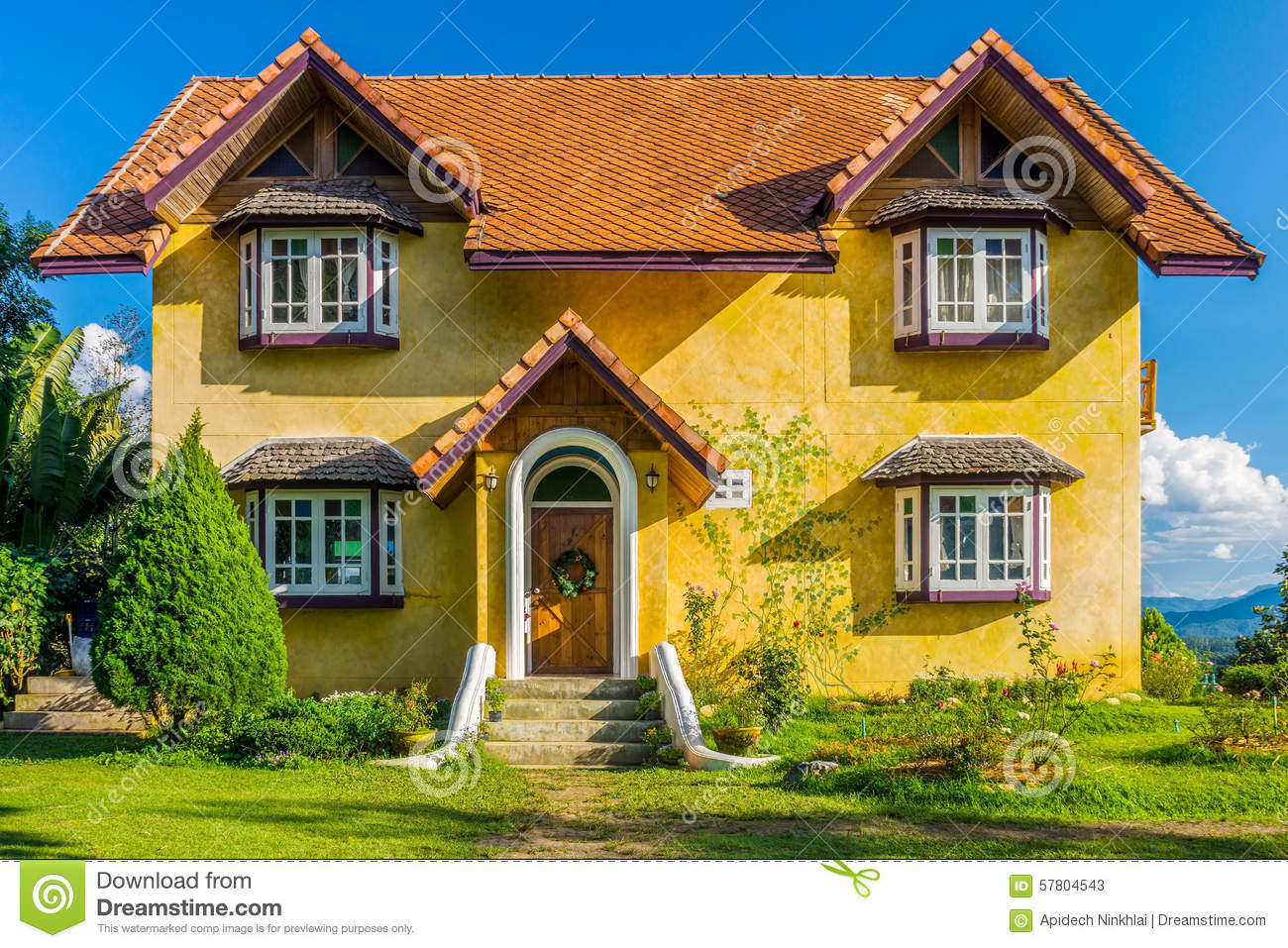 Front of vintage yellow european style house stock photo Europe style house