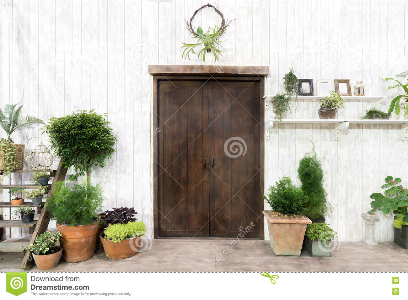 Front Wood Door And Garden Decor In White Cosy House Or