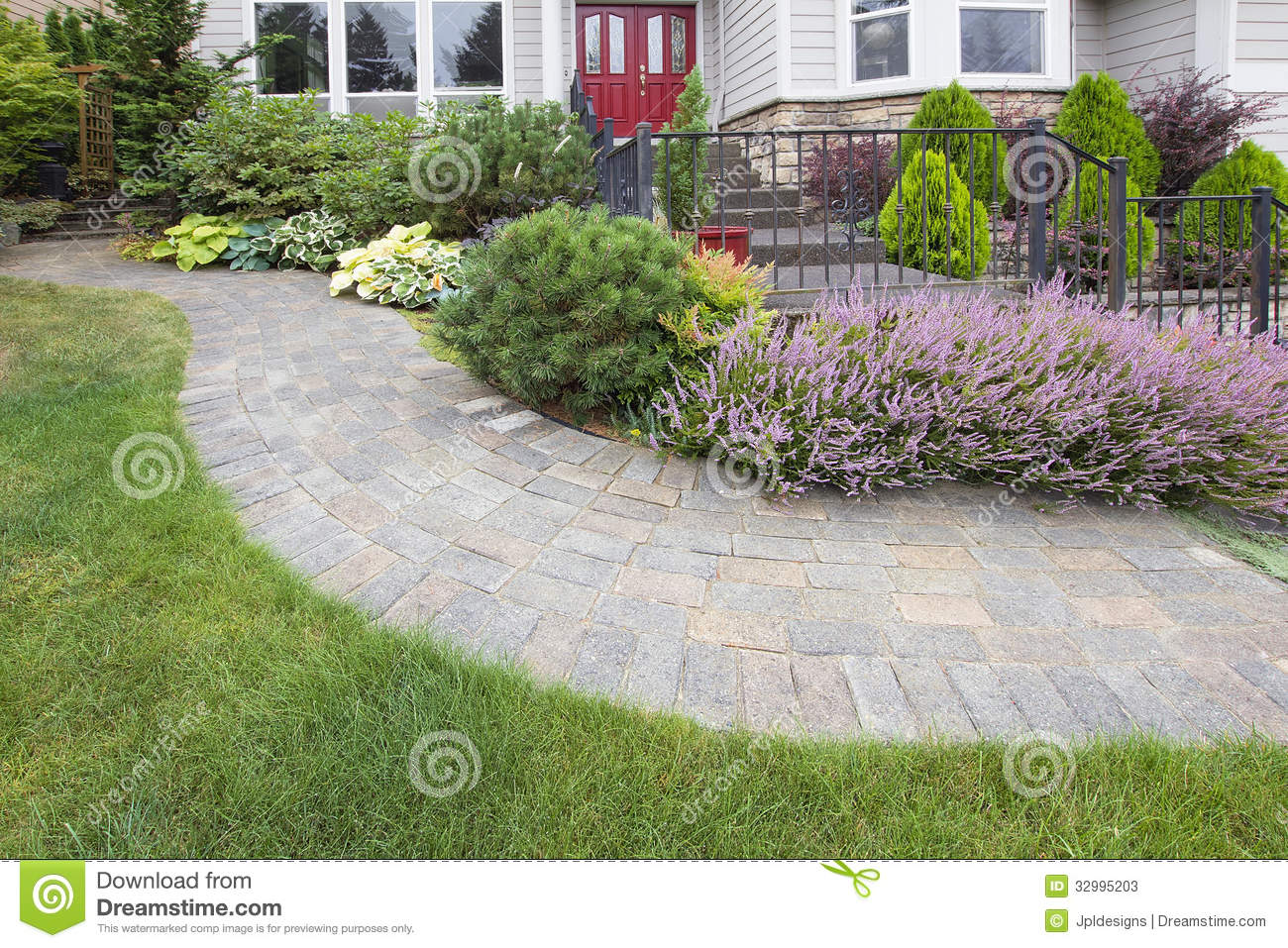 Front yard garden curve paver path stock image image for Front yard plants