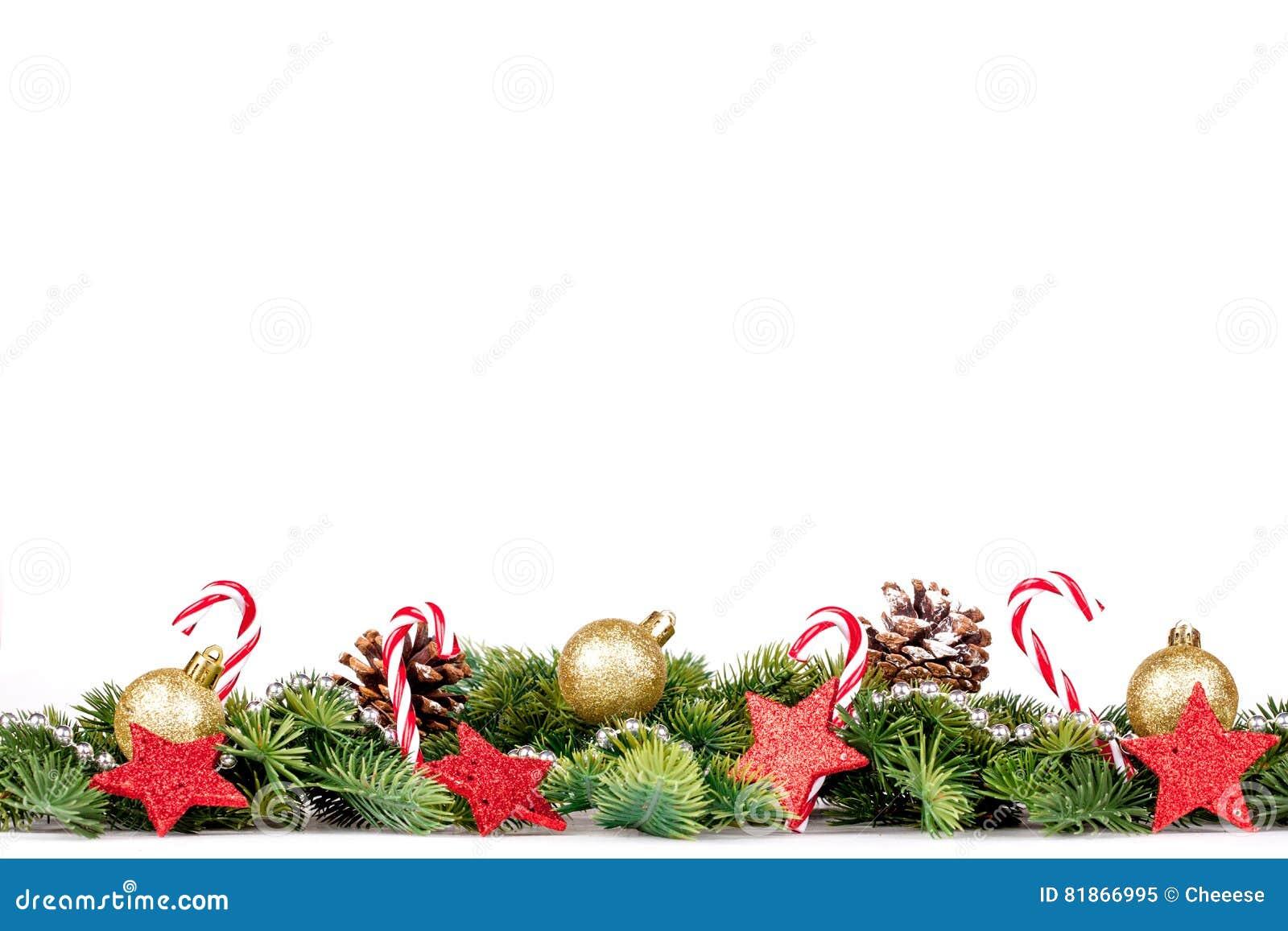 Frontera de la Navidad - ramas de árbol con las bolas, el caramelo y la decoración de oro