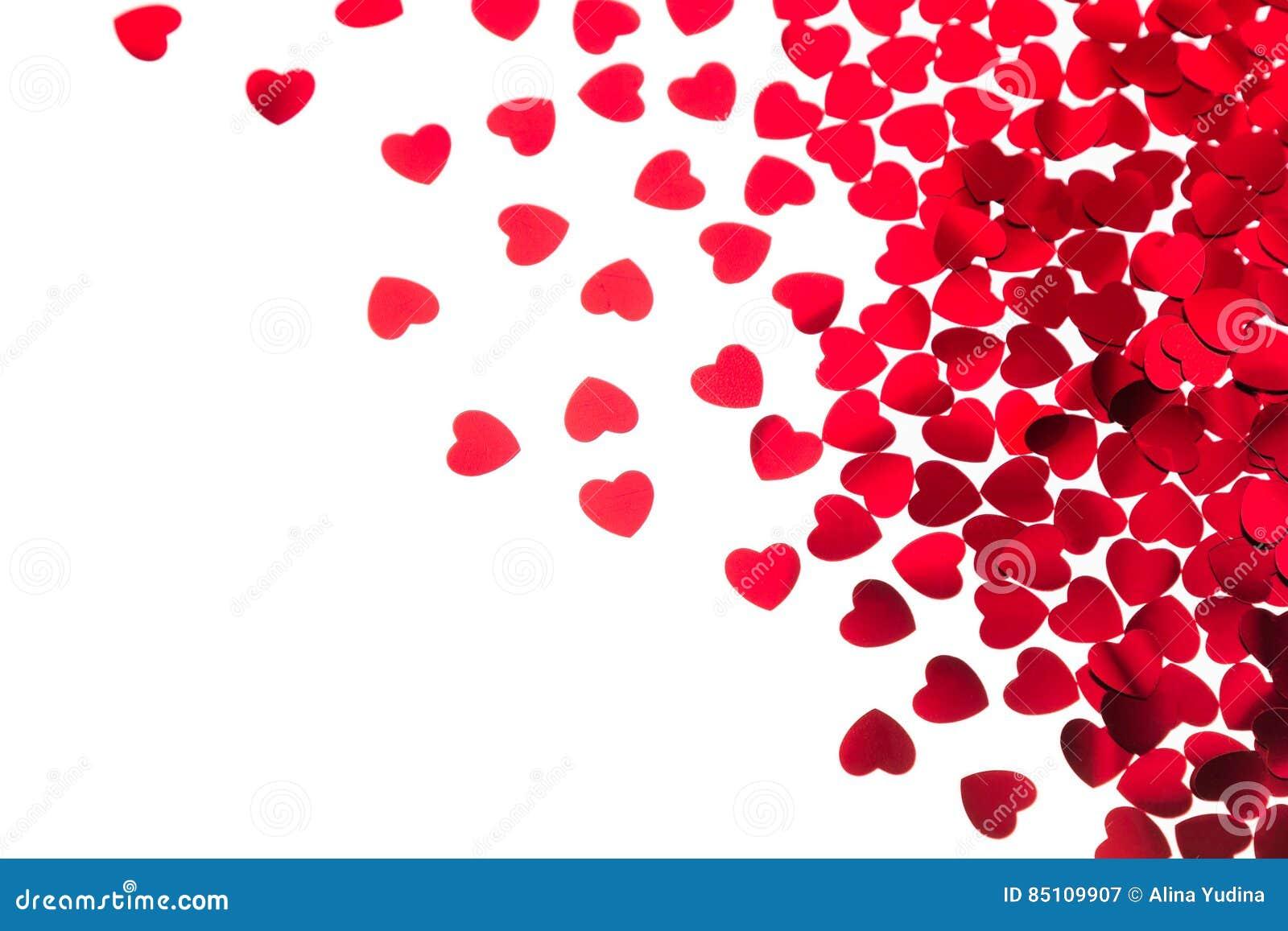 Frontera decorativa del día del ` s de la tarjeta del día de San Valentín del confeti rojo de los corazones aislado en el fondo b