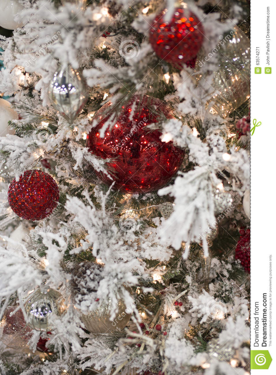 Frosted white christmas tree with red ornaments stock for White tree red ornaments
