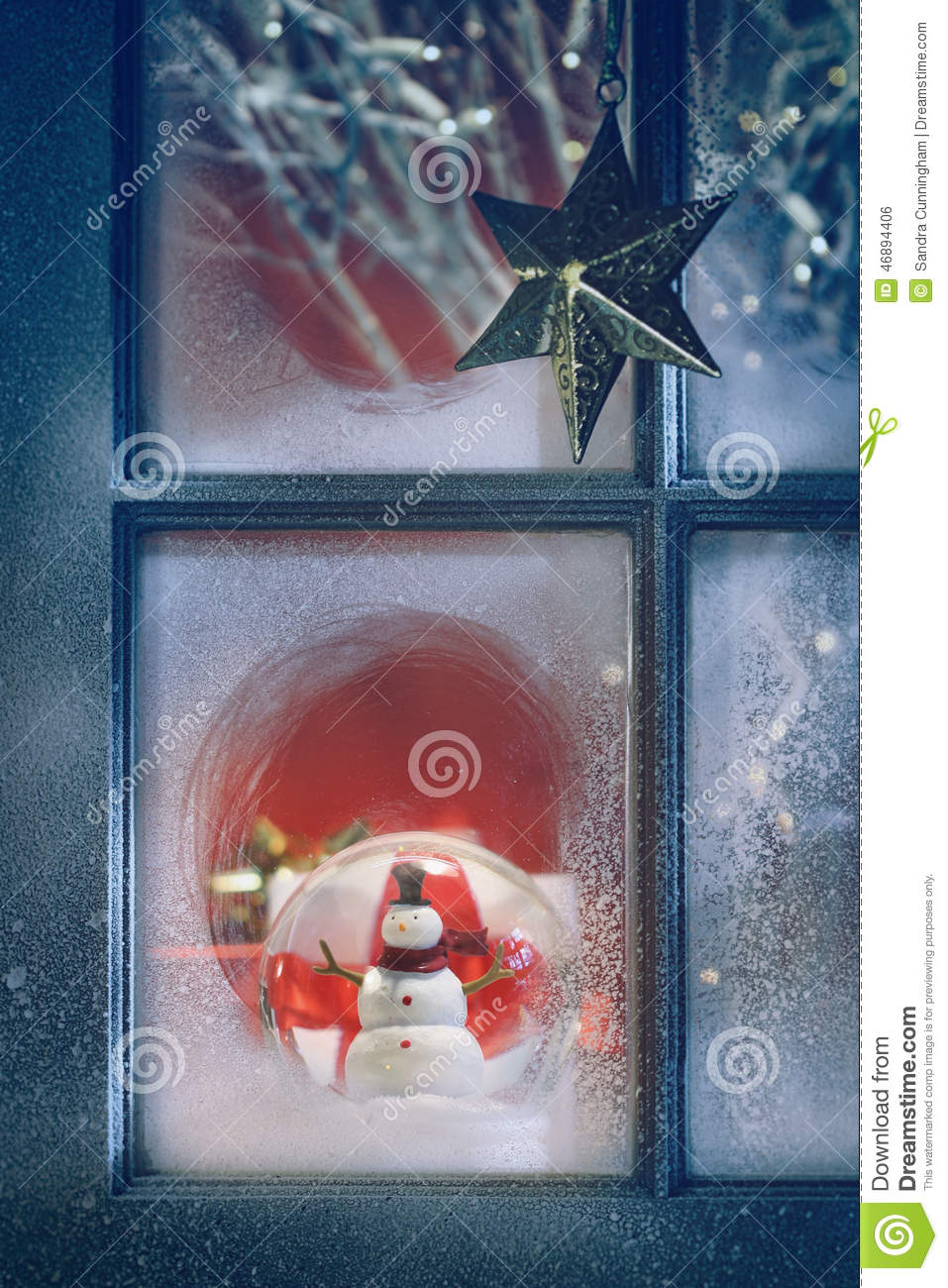Frosted window with christmas decorations inside stock for Indoor window christmas decorations