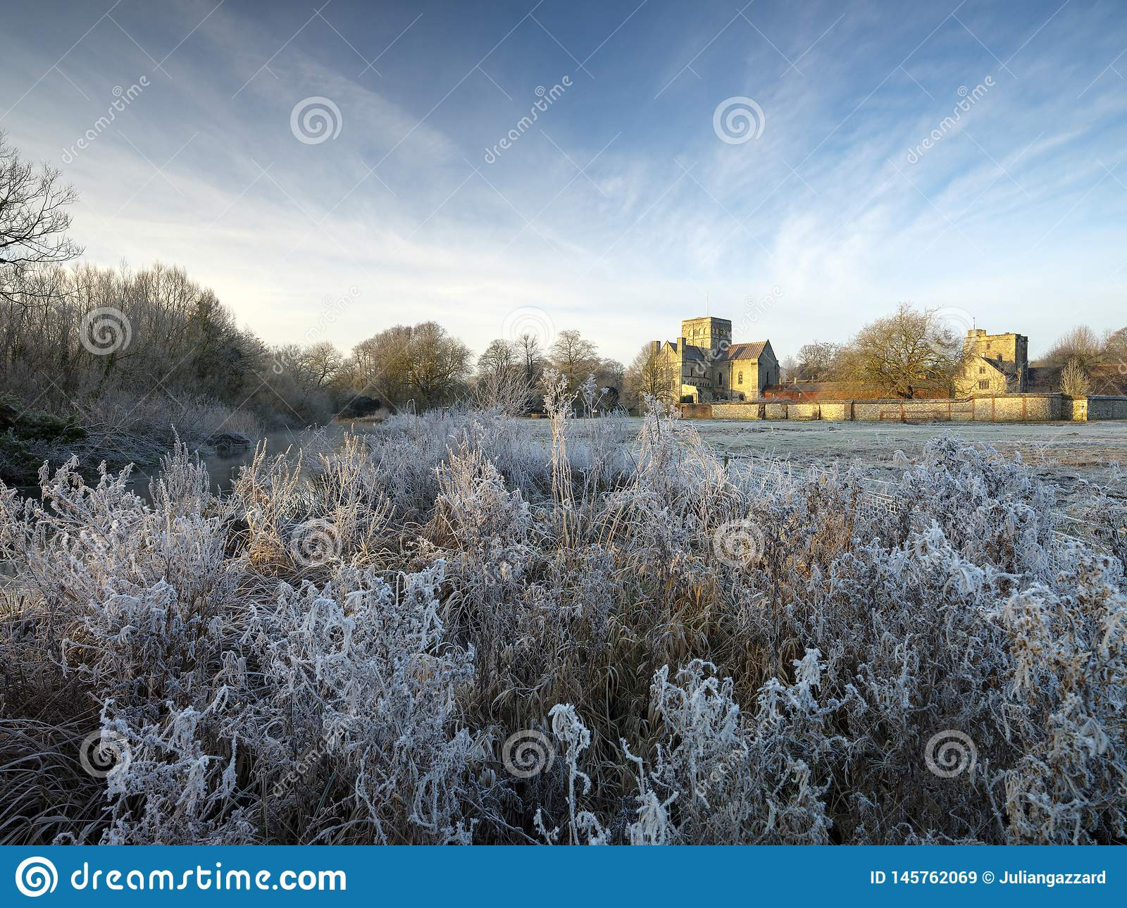 Frosty winter sunrise with a hoarfrost view of St Cross Hospital, Winchester, Hampshire, UK
