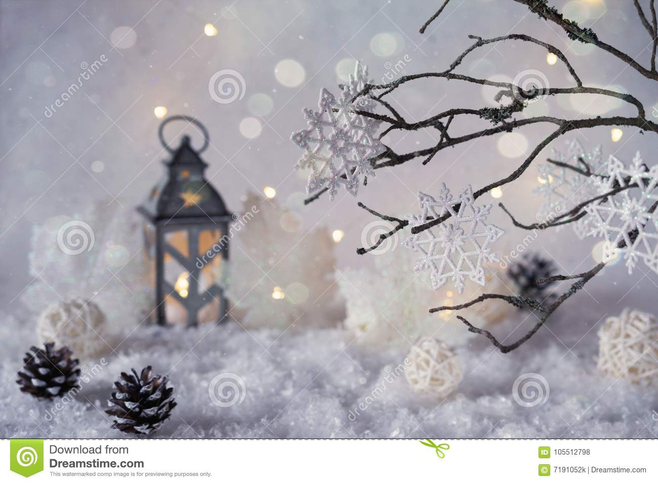 Frosty winter wonderland with snowfall and magic lights.
