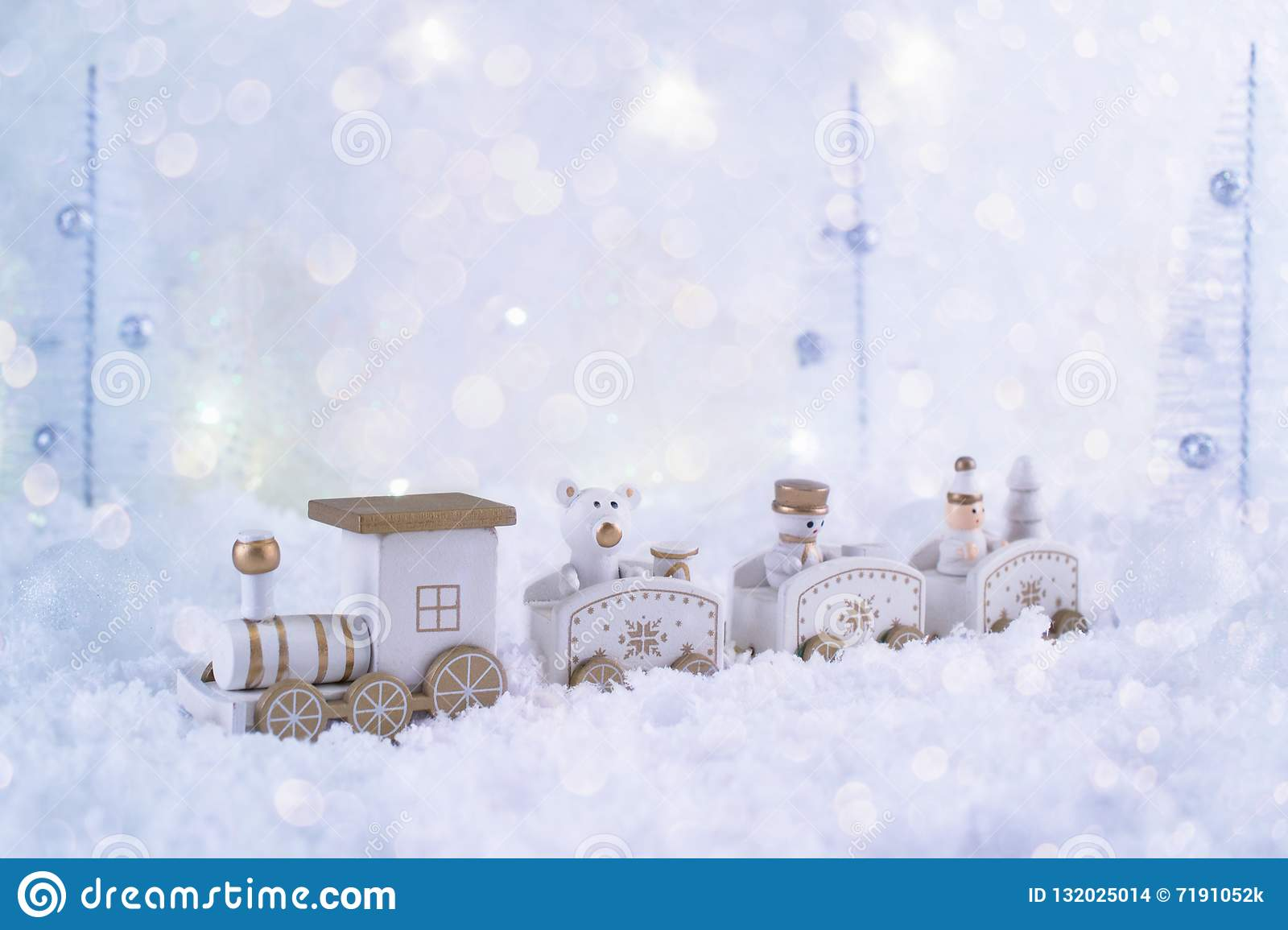 Frosty winter wonderland with toy train, snowfall and magic lights.