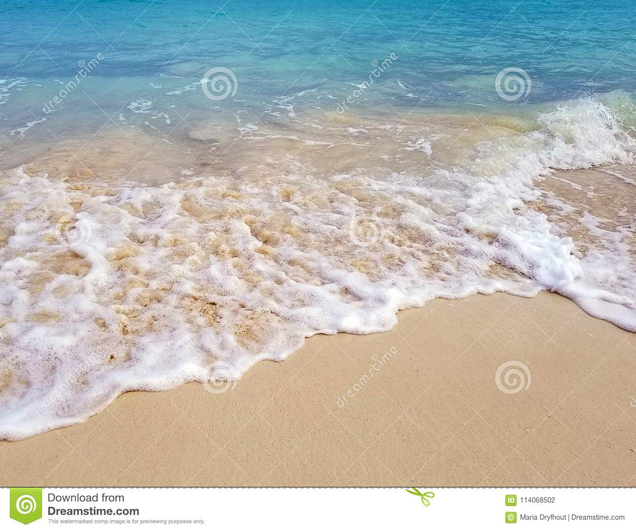 3a2f84eb339 Sandy beach and frothy foam surf on turquoise Pacific ocean seashore in  Nassau Bahamas