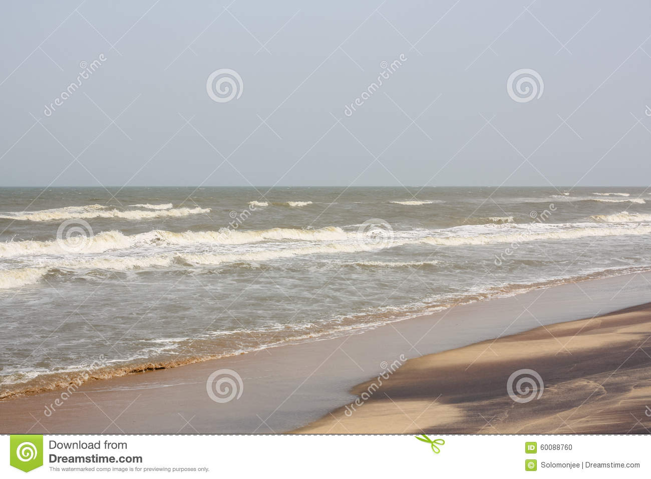 Frothy waves on beach with patterns