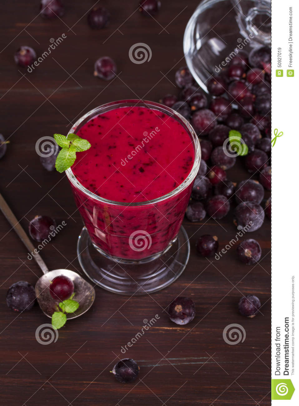 Frozen black currant berries smoothie with mint.