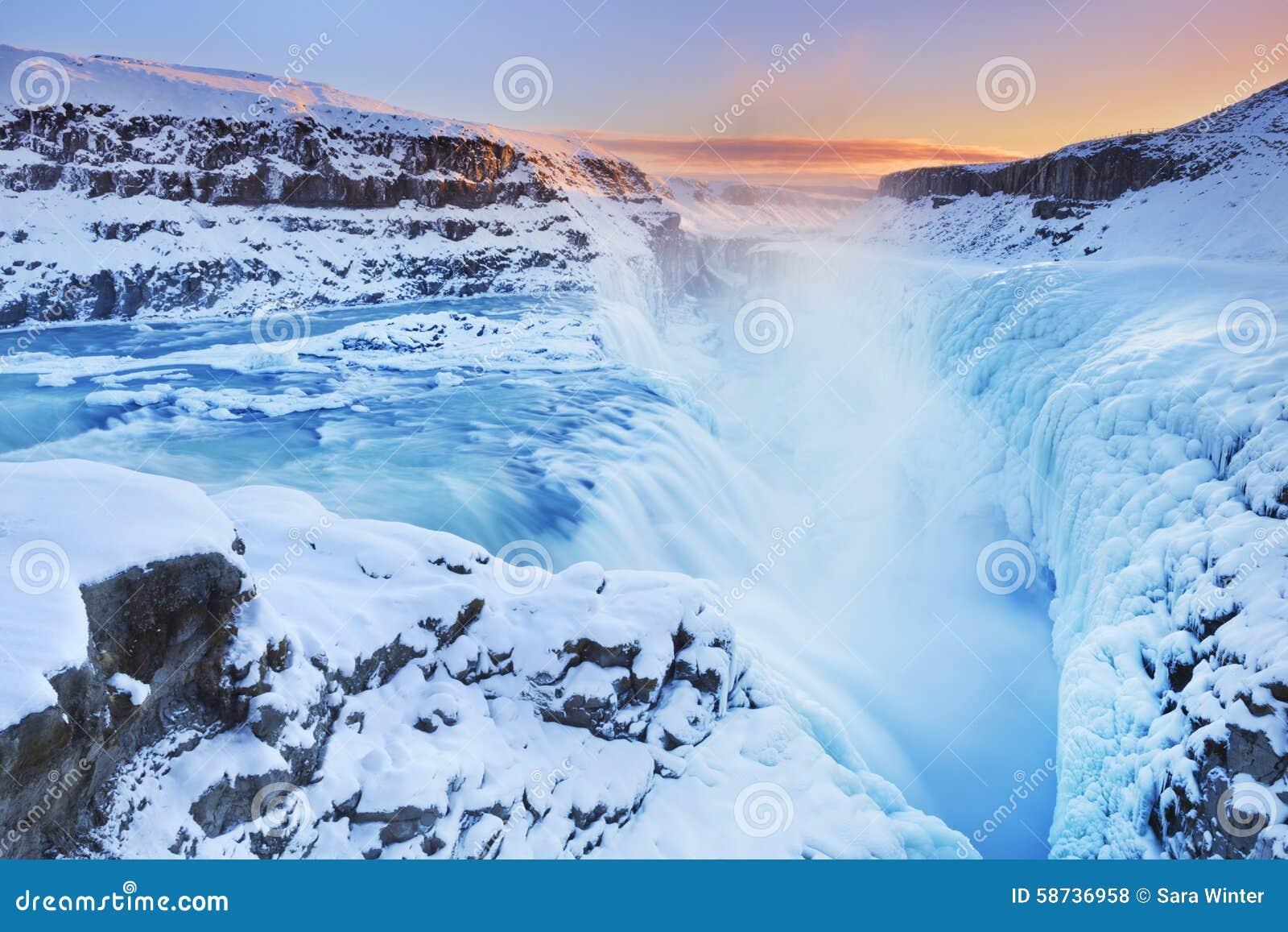 Frozen Gullfoss Falls in Iceland in winter at sunset