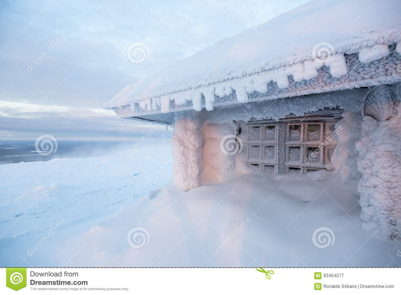 Frozen House In Finland Behind Arctic Circle Stock Photo