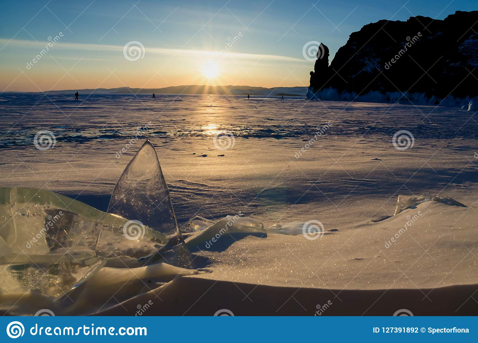 The Frozen Lake Baikal. Winter Landscape With Ice And Snow Near The Rocks Of Olkhon Island In