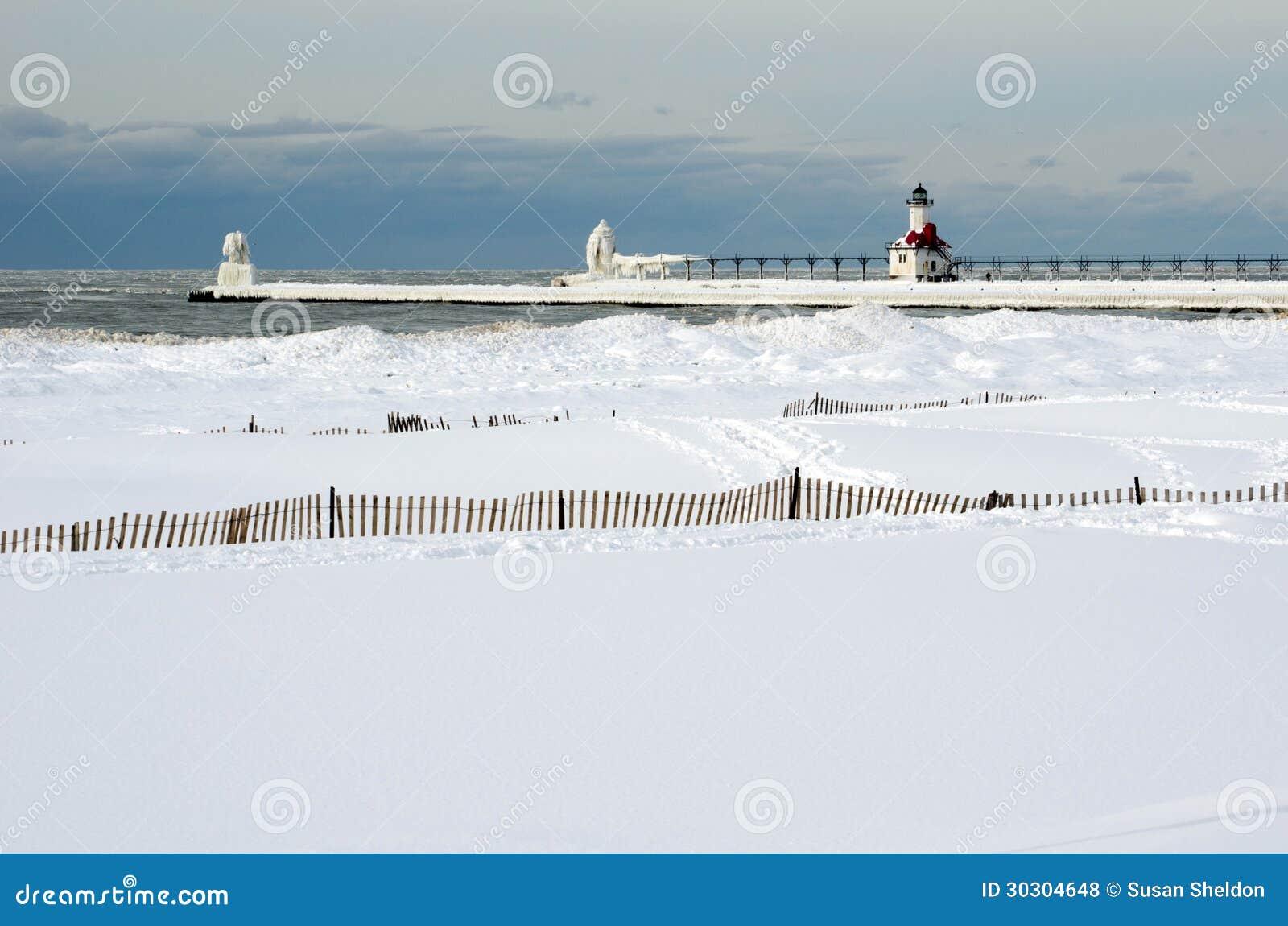 Frozen Lighthouse Landscape On Lake Michigan Royalty Free