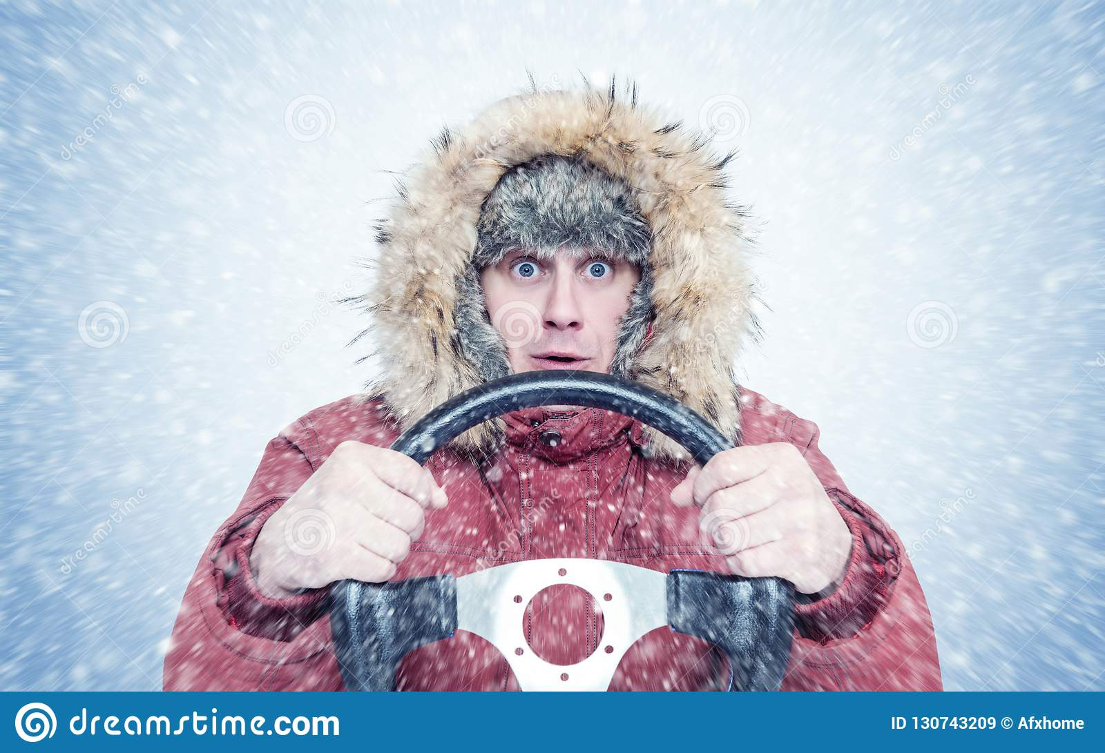 frozen man in red winter clothes with a steering wheel snow