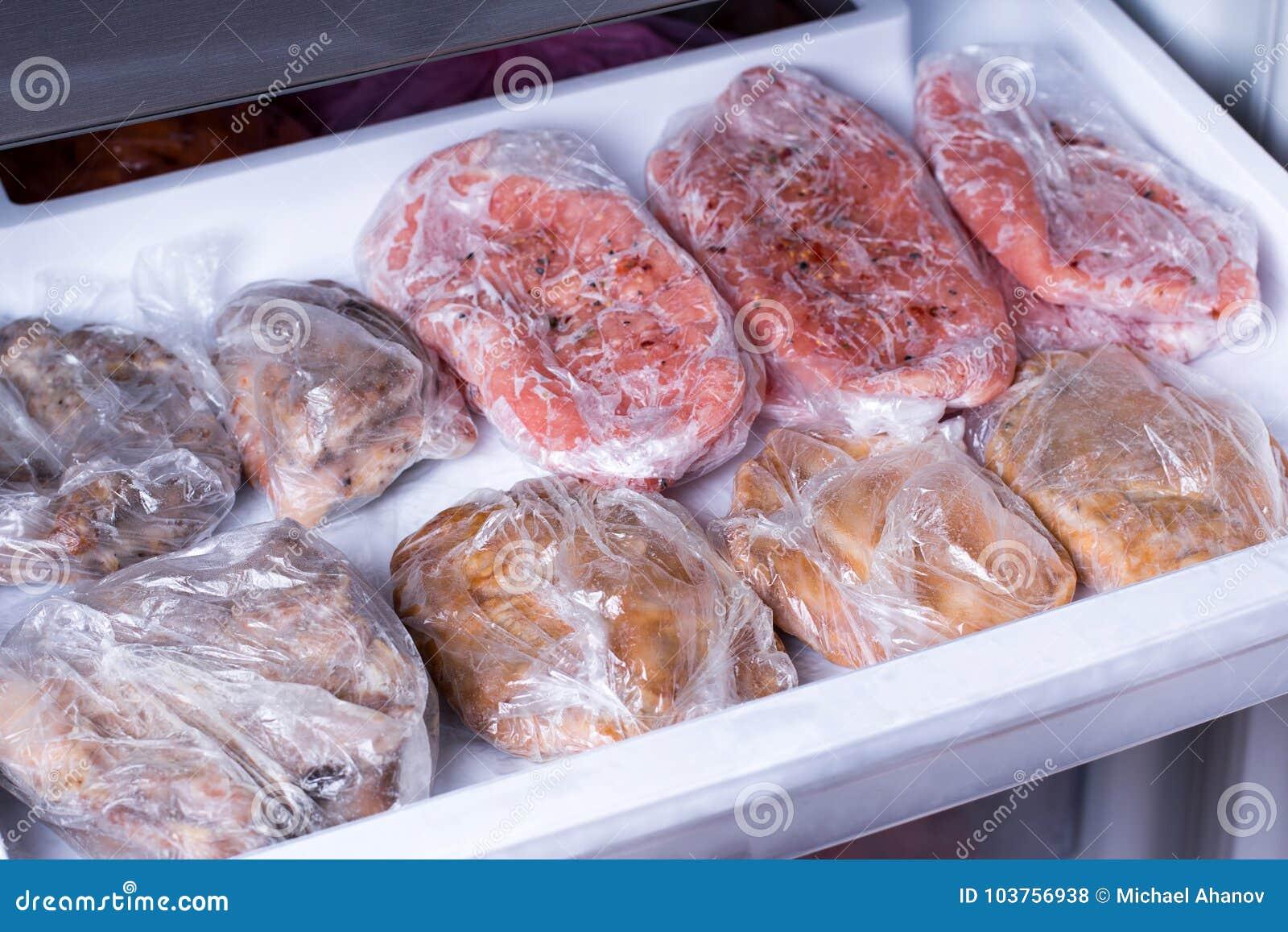Frozen pork neck chops meat steakin the freezer. Frozen food