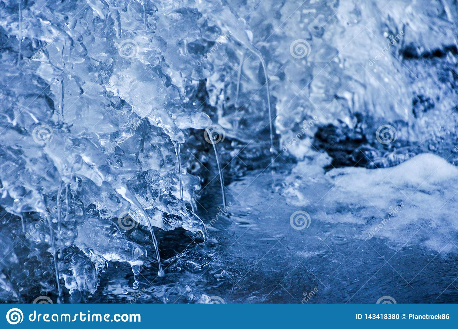 Frozen river and dripping water