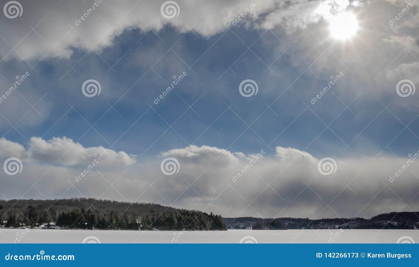 Beautiful blue sky between thick snow clouds in Haliburton Ontario