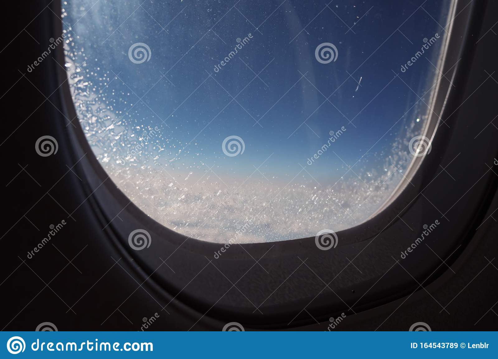 Frozen Window Inside Airplane Covered With Ice During Flight